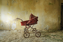 don't wanna be on top of your list (stereotopie) Tags: lost decay abandoned paintpeeling red orange kinderwagen stroller light dark