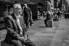 The Sitting (Leanne Boulton) Tags: people urban street candid portrait portraiture streetphotography candidstreetphotography candidportrait streetportrait streetlife old elderly man male face sitting hands clasped gesture posture mood atmosphere emotion tone texture detail perspective depthoffield bokeh naturallight outdoor light shade shadow city scene human life living humanity society culture canon canon5d 5dmkiii 70mm ef2470mmf28liiusm black white blackwhite bw mono blackandwhite monochrome glasgow scotland uk