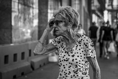 Texture of Life (Leanne Boulton) Tags: portrait urban street candid portraiture streetphotography candidstreetphotography candidportrait streetportrait streetlife old woman female lady elderly face expression skin wrinkles ageing lifetime storytelling tone texture detail depthoffield bokeh naturallight outdoor light shade shadow city scene human life living humanity society culture people canon canon5d 5dmkiii 70mm ef2470mmf28liiusm black white blackwhite bw mono blackandwhite monochrome glasgow scotland uk