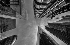 London Towers (Leipzig_trifft_Wien) Tags: london england tower skyscraper gherkin lloyds black white architecture modern contemporary perspective frogperspective pov urban skyline city travel bnw blackandwhite building lookingup upwards sky