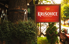 Commercial Board of Krusovice Beer (dejankrsmanovic) Tags: editorial krusovice beer czech drink beverage advertising commercial board red outdoor tree street public brand logo famous concept advert company restaurant plate day calm warm title message frame design