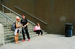 "Generation gap (Xsbmrnr (Please read profile before ""following"") Tags: colour colourfilm colours color colorfilm downtown 35mm 35mmfilm film filmphotography hamilton hamiltonontario hamont ishootfilm kingstreethamilton olympusom1 olympus om1 people street streetphotography streetpeople urban urbanphotography zuiko zuiko50mm"