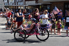 139th Annual 4th of July Parade (Adventurer Dustin Holmes) Tags: 2018 webstercounty missouri marshfieldmo marshfieldmissouri parade parades events independenceday outdoor 4thofjuly july4th annual 139th midwest riding transportation peddle humanpowered trikes recumbent pink flag americanflag usflag