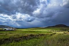 Dramatic Sky (Ulla Meyer) Tags: dramaticsky farmland hillside fujixe1 fujifilm rural