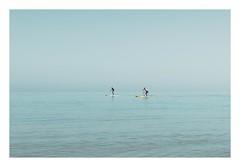 Paddle Boarders (Number Johnny 5) Tags: tamron d750 nikon calm water mood mundane watersports blue board imanoot banal topographics paddle norfolk paddleboard 2470mm seascape new coast johnpettigrew sea