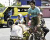 Tough Job (Beegee49) Tags: street pedicab public transport rider passengers women cargo bacolod city philippines