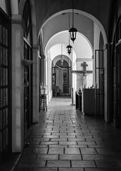 Religious Offices (ep_jhu) Tags: oldsanjuan x100f crucifix building puertorico hallway pr fujifilm arches sanjuan fuji architecture cross acros viejosanjuan osj bw