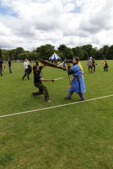 Historia Normannis Meadows June 2018-72 (Philip Gillespie) Tags: historia normannis central scotland sparring fighting shields swords axes spears park grass canon 5dsr men man women woman kids boys girls arms feet hands faces heads legs shins running outdoor tabards chain mail chainmail helmets hats glasses sun clouds sky teams solo dead act acting colour color blue green red yellow orange white black hair practice open tutorial defending attacking volunteer amateur kneeling fallen down jumping pretty athletic activity hit punch