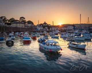 Paignton Harbour with a setting sun