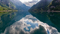Smooth as a mirror (Silvan Bachmann) Tags: switzerland swiss suisse glarus klöntal klöntalersee smooth mirror reflection clouds sky sun lake water mountains swissalps land landscape nature shot drone dji phantom photography photo