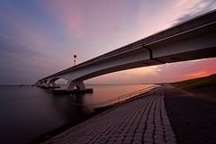 Zeelandbrug (Photodoos) Tags: canonnl irix 15mm zeelandbrug sunset longexposure zierikzee netherlands bridge