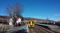 Train at Achnasheen Railway Station, Achnasheen, Highlands of Scotland, March 2018 (allanmaciver) Tags: achnasheen railway station highlands scotland yellow scotrail tree house track march remote isolation wait allanmaciver