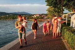 Families and colors (GPStreepher) Tags: leica leicaq sunset lake bardolino streetphotography street