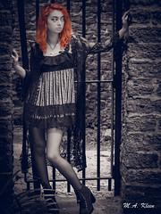 Luna Noir (makleen) Tags: purple blue noir redhair redhead lunamae goth gothgirl sunkengarden warnercastle rochester newyork monroecounty model femalemodel shawl longhair babydoll stonewall bars gate