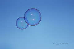 Stay close... (ggcphoto) Tags: foambubbles blowing wind sky blue closeup reflections closetogether nexttoeachother