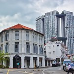 The modern architecture of The Pinnacle @ Duxton looming over heritage buildings in Chinatown, Singapore thumbnail