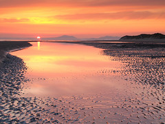 Sunset over the Lleyn Peninsula (jeff.dugmore) Tags: wales cymru britain uk europe snowdonia dyffrynardudwy landscape seascape shore sunset sea sand lleynpeninsula dyffrynbeach ocean water reflection mountain sanddunes serene tranquil scenic moody outside outdoors gold orange cloud tide snowdonianationalpark nationalpark dusk golden olympus nisi bay nature