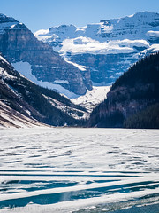 _5227872 (Hyperfocalist) Tags: canada alberta spring rocky mountains lake louise frozen ice water mountain forest trees snow glacier valley