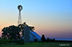 Farmstead at Dusk_187656 (rjmonner) Tags: rural relic rustic windmill windmillwednesday barn blue farm field farmland farmstead farmyard farming fields iowa isolated sky sunset summer shed agriculture agricultural agronomy agronomic architecture acreage acres trees tree pastoral sun sundown summertime dusk midwest country blades adel dallascounty corn cornbelt silo twilight nightfall outbuilding tower sentinel guard keeper lookout watchman