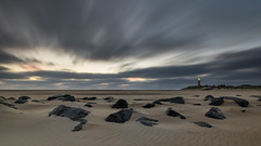 Early morning at Texels lighthouse (Rob Schop) Tags: f11 wideangle zonsopkomst sand landscape hoyaprofilters sonya6000 nederland outdoor sea noordzee clouds groothoek longexposure ochtend beach le sunrise strand pola rocks samyang12mmf20 vuurtoren seascape a6000 nd64 wolken texel