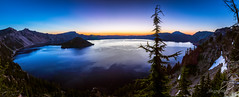 First Light Crater Lake - Panorama (ProPeak Photography - Thanks for 800,000 views!) Tags: america blue bluehour blueskies bluesky caldera craterlake devilsbackbone discoverypoint famousplace firstlight green hillmanpeak internationallandmark island lake mountmazama nps nationalpark northamerica oregon red summer sunrise thewatchman touristattraction traveldestination travelandtourism trees usa volcano water wizardisland yellow snow