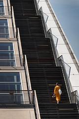 136 steps (michael_hamburg69) Tags: germany hamburg deutschland dockland hafen bürogebäude büro office building parallelogramm schiff woman stairs treppe orange dress kleid
