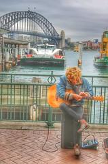 Playing in the right quay (Gunn Shots.) Tags: busker streetmusician circularquay sydney australia urban ferry boat bridge harbourbridge hdr guitar quay