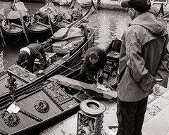 After the Rain. Venetian Gondoliers (raymorgan4) Tags: venezia venice italia italy raining gondola gondoliers fujifilm fujifilmx100f fujifilmglobal x100f blackandwhite cleaning tourists wet day