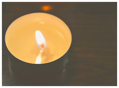 Enchantment speaks in whisper... (सफेद रसगुल्ला) Tags: candles light church jesus fire night candle indoor shadow hope love peace flames positivity aura lightphotography photography nightphotography churchcandles depth blur bright black background food abstract depthoffield people photo