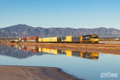 With the Flinders Rangers as the backdrop, NR59 hauls 7AX7 as it crosses over Lake Knockout at Port Augusta. (Australian Trains) Tags: railways australia train trains transport transportation australian rail railway locomotive locomotives freight gauge railroad loco power railroads photos photography corey gibson railpage track tracks engine class