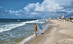 Boogie Girl (Andy Zito) Tags: beautiful young lady holding boogin board beach bikini sand ocean waves tides crashing huge clouds overhead scene up boogie gulf shores alabama