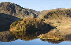 Classic Haweswater (Benjamin Driver) Tags: haweswater haweswaterreservoir reservoir scape landscape landscapes waterscape reflection reflections hills hill orange sun sunrise rise still lakedistrict cumbria forest tree wood water lake district rocks trees