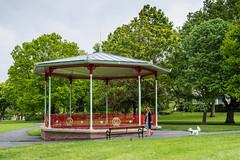 Bandstand - Victoria Park, St Helens (Peter.Bartlett) Tags: bandstand olympusomdem5 unitedkingdom bench people walking urbanarte colour peterbartlett urban uk m43 microfourthirds dog park woman lunaphoto