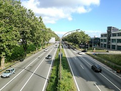 Bridge view (Ryi Aquir) Tags: road bridge cars building lamp grass tree sky cloud