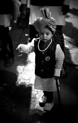 Waiting to grow up (magiceye) Tags: child monochrome street blackandwhite streetphoto bnw koli holi festival vesave versova mumbai india streetportrait