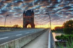 Rheinbrücke am Morgen (andreasrauschfotografie) Tags: sonnenaufgang sunrise canon 1855 eos 450d belichtungsreihe hdr brücken bridges cloudporn dawn sky clouds light sun summer bridge street