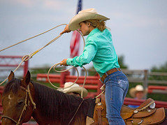 (emmett.hume) Tags: girl cowgirl woman lasso horse rodeo beauty blonde glamour charm skill achievement performance determination country west america summer tradition feminine hat rope competition contest athlete equestrian green animal ranch jeans denim