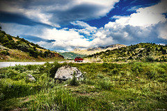 Crossroads... (Constantinos_A) Tags: sony alpha a6300 sky field mountain tree soil bushes clouds storm green yellow blue nature landscape outdoors trikala peloponnese mountainside dirt greece grass animal road forest
