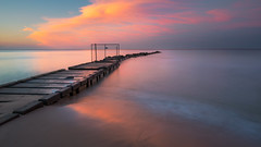 Fading Glory (David Colombo Photography) Tags: sunset milwaukee wisconsin pier lakemichigan lake clouds color water beach sand fence stone vibrant landscape seascape nikon