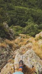 A Step Away from Adventure (benjamin.t.kemp) Tags: rocks trees green grass dry foot shoe adventure walk cliffside trek