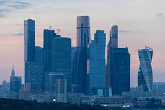 Skyline of Moscow at sunset (marcoverch) Tags: fusball fans deutschland fusballwm football wm2018 moskau russland2018 moskva russland ru downtown innenstadt architecture diearchitektur skyscraper wolkenkratzer city stadt skyline horizont cityscape stadtbild business geschäft office büro building gebäude finance finanzen tallest höchste sky himmel noperson keineperson travel reise dusk dämmerung modern urban städtisch tower turm waterfront direktamwasser contemporary zeitgenössisch head fun transport fish second town bicycle 7dwf waves landschaft moscow sunset