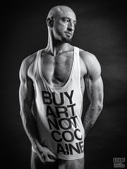 'Youth to itself rebels, though none else near - III' (Matthias 14) (WF portraits) Tags: pol man male portrait studio black white buyart muscles fitness beard hairy bald tshirt message chest