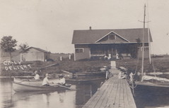"""NW Onekama Manistee MI c.1910 RPPC CAMP SIGN ON THE BUILDING WOOD SAIL AND ROW BOATS AT THE CAMP DELIGHT DOCKS Waterfront Docks on Portage Lake1 (UpNorth Memories - Donald (Don) Harrison) Tags: vintage antique postcard rppc """"don harrison"""" """"upnorth memories"""" upnorth memories upnorthmemories michigan history heritage travel tourism restaurants cafes motels hotels """"tourist stops"""" """"travel trailer parks"""" cottages cabins """"roadside"""" """"natural wonders"""" attractions usa puremichigan """" """"car ferry"""" railroad ferry excursion boats ships bridge logging lumber michpics uscg uslss"""