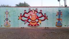 Mother and child (radargeek) Tags: cellphone az arizona tucson mural tile mosaic woman child mermaid skulls