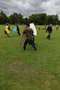 Historia Normannis Meadows June 2018-766 (Philip Gillespie) Tags: historia normannis central scotland sparring fighting shields swords axes spears park grass canon 5dsr men man women woman kids boys girls arms feet hands faces heads legs shins running outdoor tabards chain mail chainmail helmets hats glasses sun clouds sky teams solo dead act acting colour color blue green red yellow orange white black hair practice open tutorial defending attacking volunteer amateur kneeling fallen down jumping pretty athletic activity hit punch