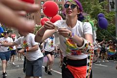 Rainbow Mickey (sjnnyny) Tags: adaptedlens mf nikkor28f28ais stonewall49 nyc manhattan people march demonstration parade stickers balloon festival gaypride logo publicrelations corporatepromotion diversity rainbowsymbol sonya6300 stevenj sjnnyny streetphotography