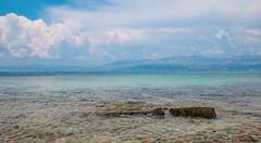 Blue Landscape (benjamin.t.kemp) Tags: blue water sea green colours colors colorsinourworld rock clouds sky