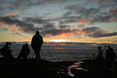 Everyone trying to catch the last light (briangeerlings) Tags: capeperpetua oregon yachats cookschasm thorswell oregoncoast coast pacificocean ocean sky clouds nature landscape sigmadp2merrill foveon rocks sunset color pink yellow red blue silhouette people photographers reflection water