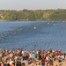 Spectators and triathletes during swim in the background