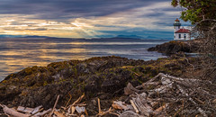 Golden Hour - Lime Kiln Light Panorama (ProPeak Photography - Thanks for 800,000 views!) Tags: america architecture blue buildings canada clouds deadmansbay driftwood famousplace goldenhour green harostrait internationallandmark island landmark landscape lighthouse limekilnlight limekilnpoint limekilnpointstatepark longexposure mountains nationalregisterofhistoricplaces northamerica panorama red rocks sanjuanisland scenic sunrays sunset touristattraction traveldestination travelandtourism trees usa unitedstates vancouverisland washington water waves yellow ngc